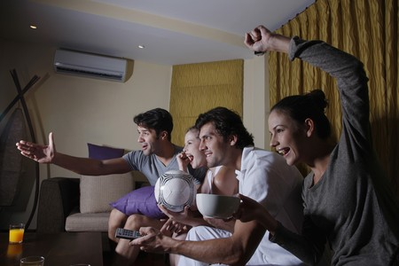 Couples watching soccer on tv together photo
