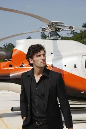 Businessman with helicopter in the background Stock Photo - 7446511