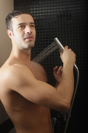 bare waist: Man taking shower Stock Photo