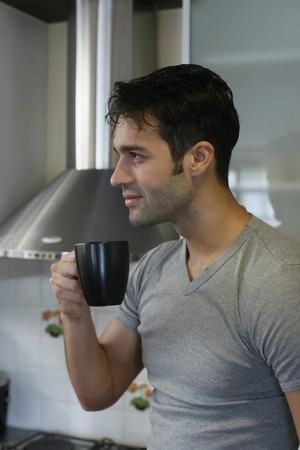 southeastern european descent: Man enjoying a cup of coffee