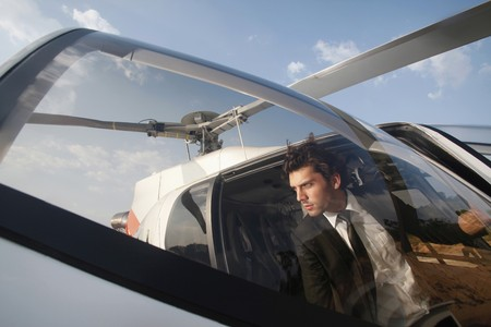turkish ethnicity: Businessman stepping out of helicopter