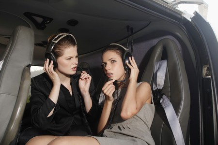 Businesswomen with headset in helicopter Stock Photo - 7446456