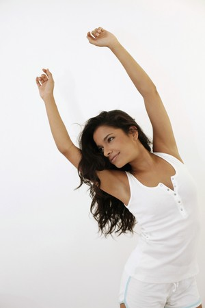 Woman dancing with her arms raised photo