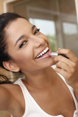 Woman applying lipstick Stock Photo - 7446549