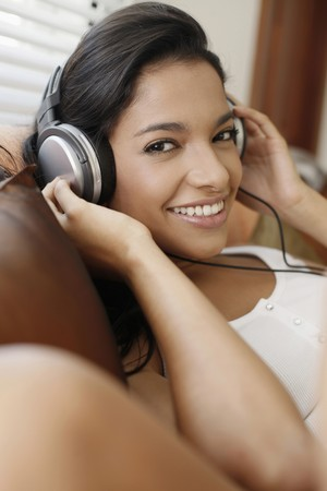 Woman listening to music on the headphones Stock Photo - 7446360