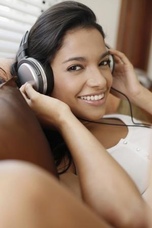 Woman listening to music on the headphones Stock Photo - 7446360