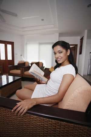Woman reading book in the living hall Stock Photo - 7446554