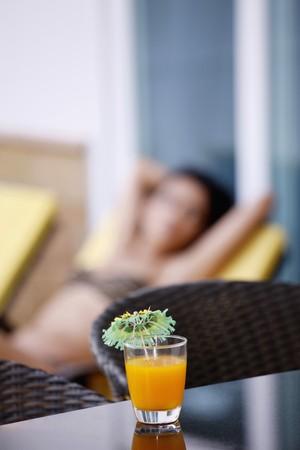 Little umbrella on a glass of orange juice photo