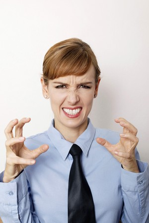 clenching teeth: Angry businesswoman clenching her teeth