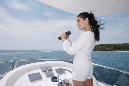 Woman holding binoculars Stock Photo - 7446044