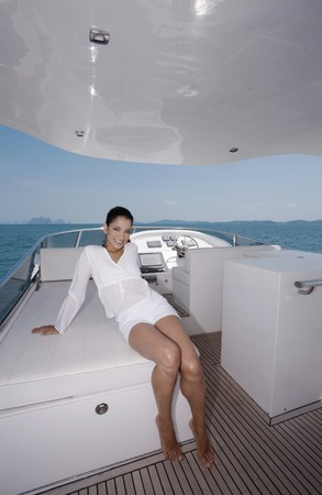 Woman relaxing on yacht Stock Photo - 7446142
