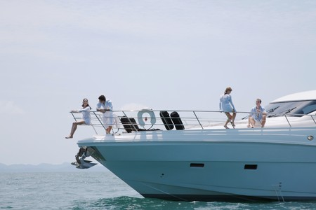 Two couples relaxing on yacht photo