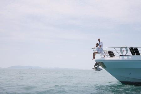 brazilian ethnicity: Couple relaxing on yacht Stock Photo