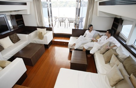 Couple relaxing in yacht living room photo