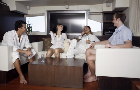 australian ethnicity: Couples relaxing in yacht living room