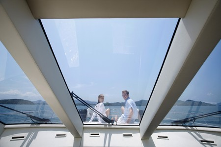 Couple sitting on yacht deck photo