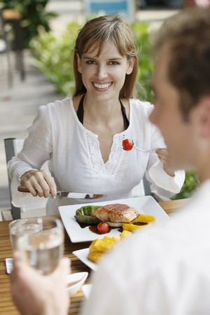 Man and woman having lunch at restaurant