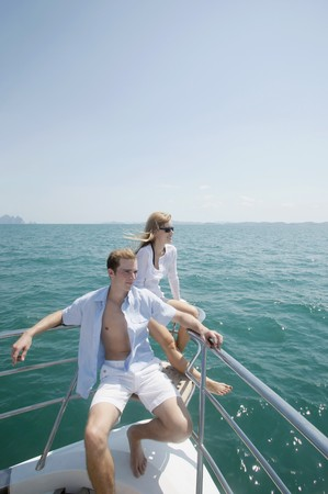 Couple relaxing at the tip of the yacht Stock Photo - 7446296