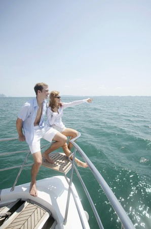 Couple relaxing at the tip of the yacht Stock Photo - 7446619