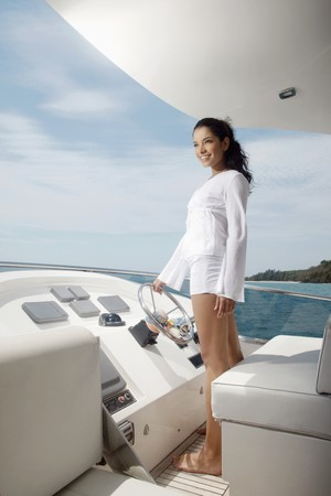yachts: Woman steering yacht