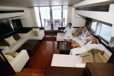 Couples relaxing in yacht living room Stock Photo - 7446514