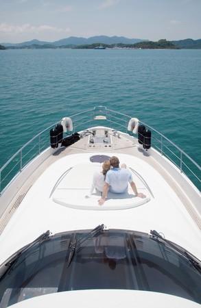 luxury yacht: Couple sitting on yacht deck