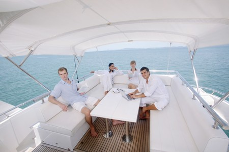 Couples relaxing on yacht photo