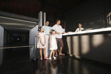 Family checking into resort photo