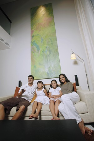 Family watching tv together Stock Photo - 7446102