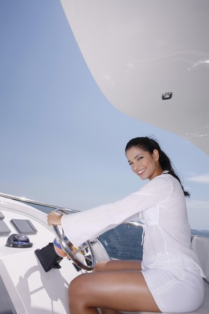 Woman steering yacht Stock Photo - 7478101