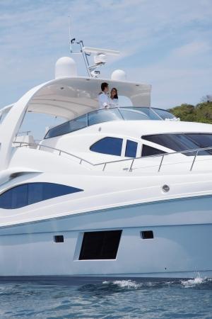 luxury yacht: Couple embracing on yacht