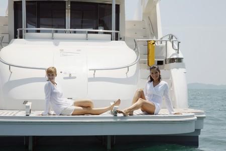 Women relaxing on yacht photo