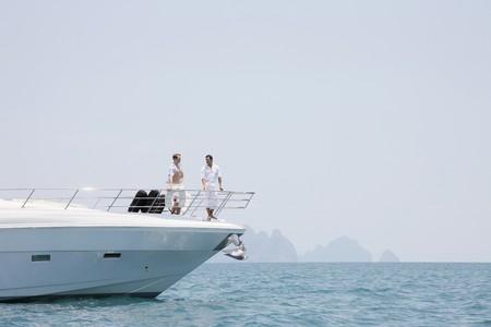 Men standing on yacht photo
