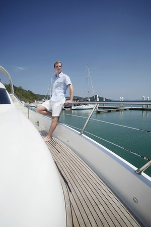 australian ethnicity: Man standing on deck of yacht Stock Photo