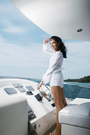Woman steering yacht Stock Photo - 7478131