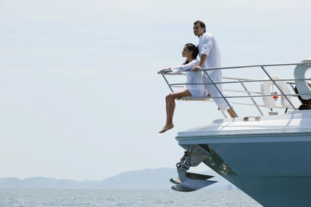 lifestyle: Couple relaxing at the tip of the yacht Stock Photo