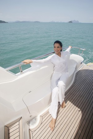 Woman relaxing on yacht photo