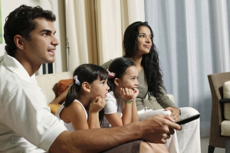 watching tv: Family watching tv together Stock Photo