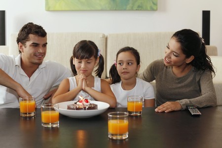 Family celebrating girl's birthday Stock Photo - 7478190