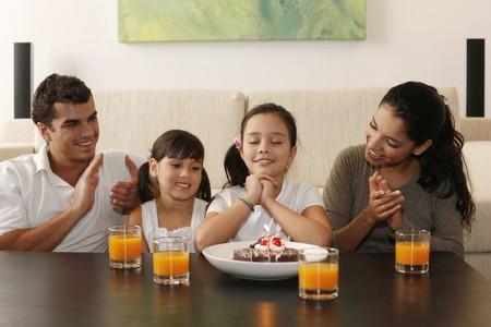 Family celebrating girl's birthday Stock Photo - 7478185