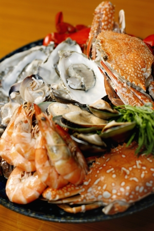 crabs: Seafood platter with sydney rock oysters, black and blue crab, rock lobster, tiger prawns, mussels, clams and cockles Stock Photo