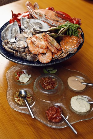 Seafood platter with sydney rock oysters, black and blue crab, rock lobster, tiger prawns, mussels, clams and cockles served with an array of dips to share