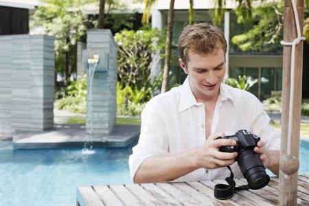 Man playing with digital camera Stock Photo - 7534936