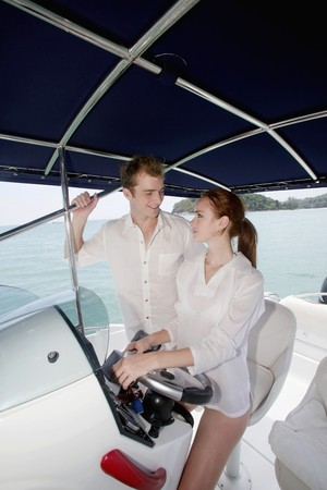 Woman steering speedboat and looking at man Stock Photo - 7534747