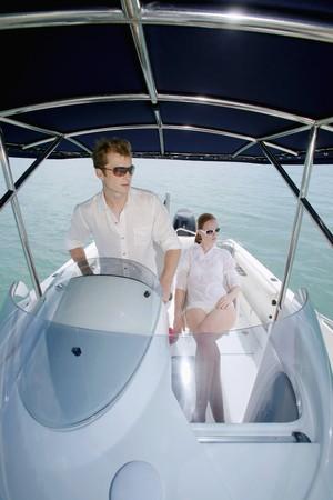 Man steering speedboat, woman sitting beside him Stock Photo - 7534759