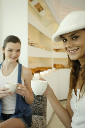 Woman enjoying coffee at bakery Stock Photo - 7534463