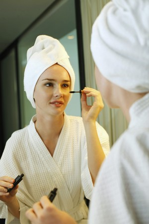 Woman applying mascara Stock Photo - 7534508