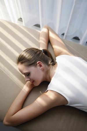 Woman lying down on lounge chair Stock Photo - 7535062