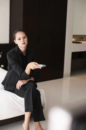 Businesswoman holding remote control photo