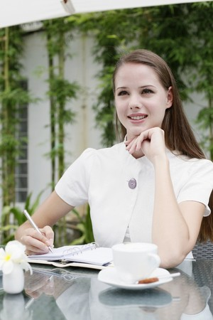 Woman writing in organizer Stock Photo - 7534972